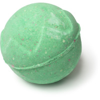 A green spherical bath bomb with a red interior on a bright background