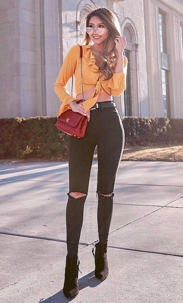 amazing outfit idea / boots + black rips + bag + yellow ruffle top