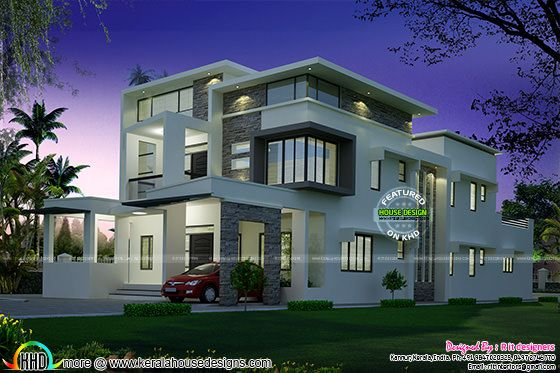 Flat roof contemporary home night view