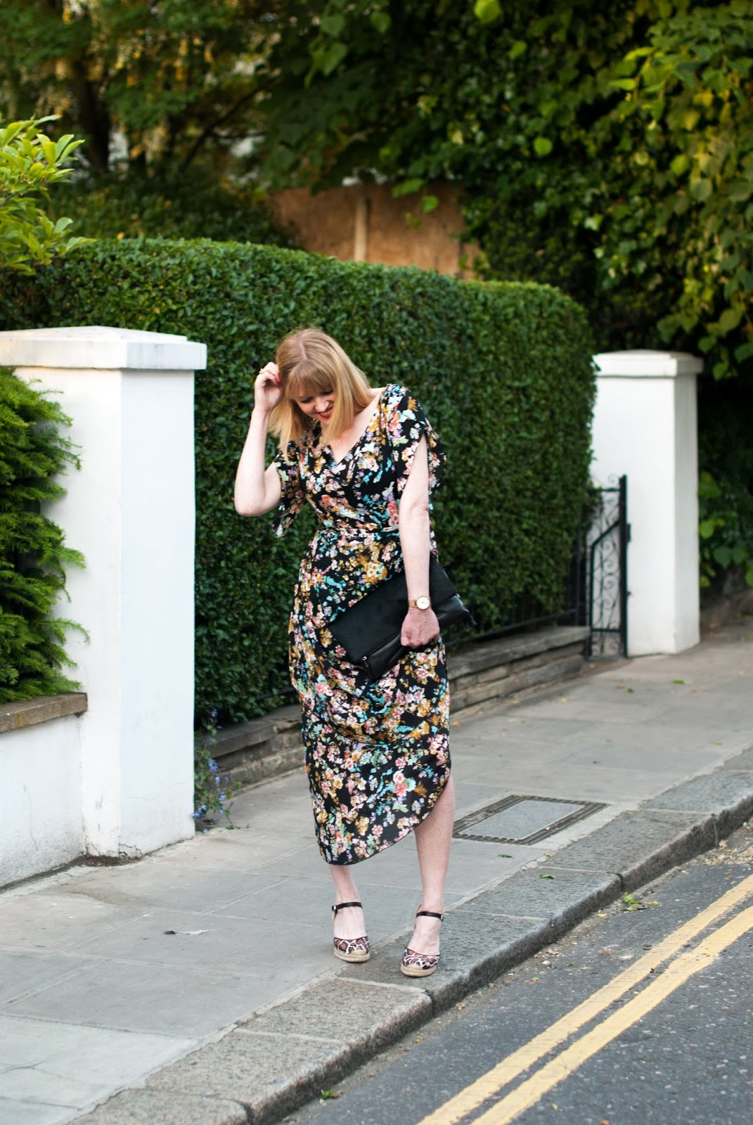 Floral draped vintage style dress with leopard  wedge print espadrilles and black clutch, over 40 style