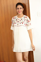 Lavanya Tripathi in Summer Style Spicy Short White Dress at her Interview  Exclusive 235.JPG