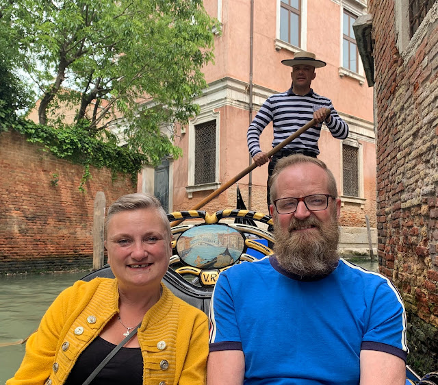 madmumof7 and husband on Gondola in Venice.