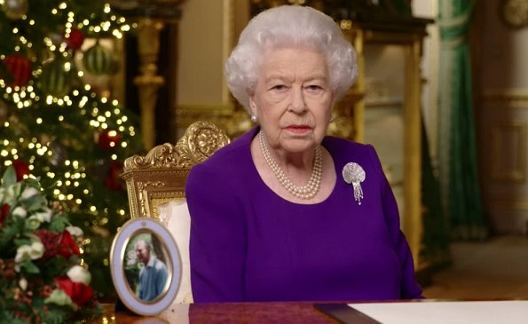 Queen Elizabeth wore an Angela Kelly rich purple dress with a Queen Mother diamond and mother of pearl shell brooch. The Duchess of Cambridge