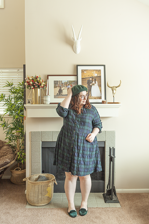 Forest green beret, green and navy blue plaid baby doll dress, green faux velvet loafer.