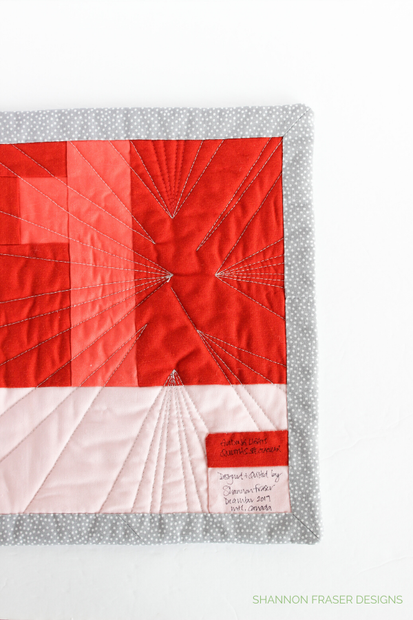 Faced Binding & Modern Improv Backing on the Guiding Lights Mini Quilted Wall Art | Shannon Fraser Designs #miniquilt #fiberart #facedbinding #improvquilting