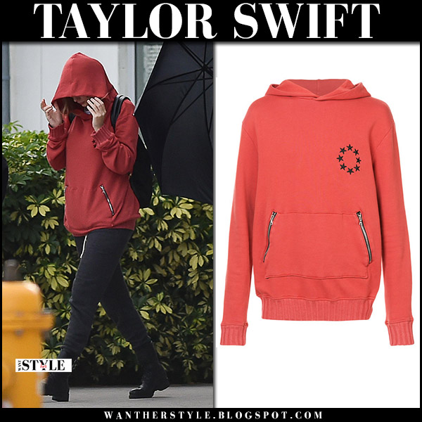Taylor Swift in red hoodie amiri and black pants street style december 19 2017