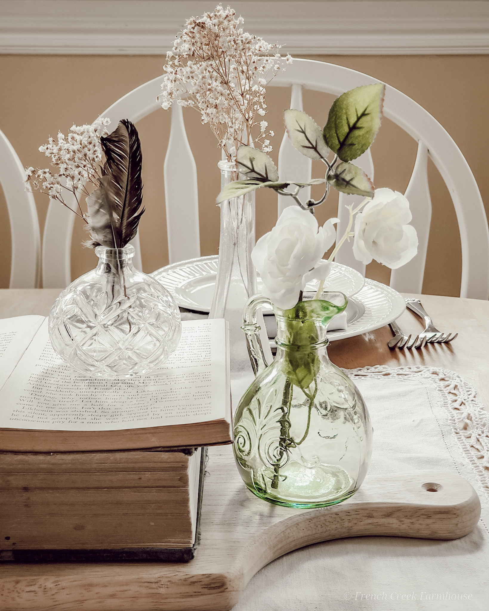 Small vintage glass vases filled with baby's breath as a centerpiece