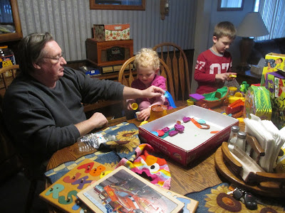 Pop and the grandkids playing with play dough