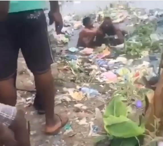 Viral video of two Nigerian women  fighting in a dirty pond (video)