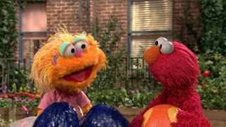 Elmo is trying to bounce the ball three times when Zoe is waving pompoms. Sesame Street Episode 4420, Three Cheers for Us, Season 44