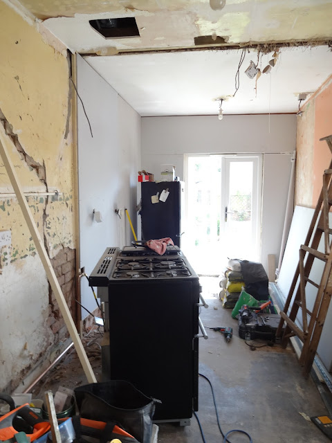 affixing plasterboard in the kitchen
