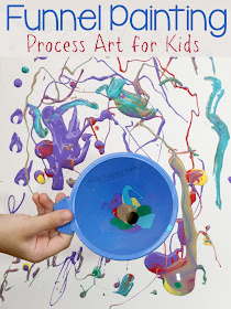 Use funnels and paint as a fun process art invitation for kids!