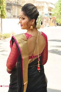 Actress Madhavi Latha Stills in Saree at Anushtanam Movie Audio Launch  0020.JPG
