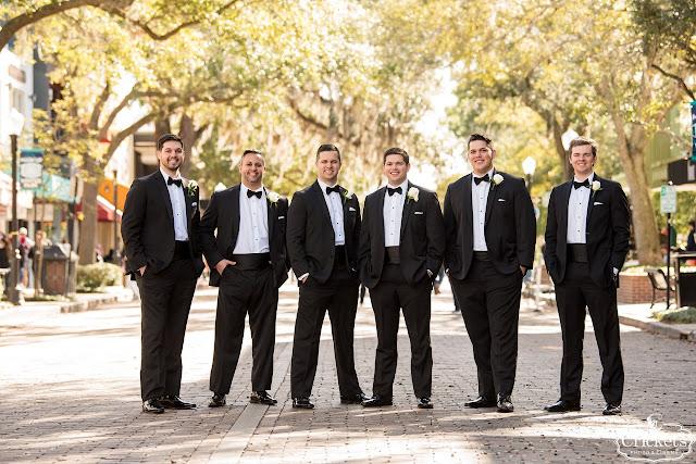 groom and groomsmen in black tux