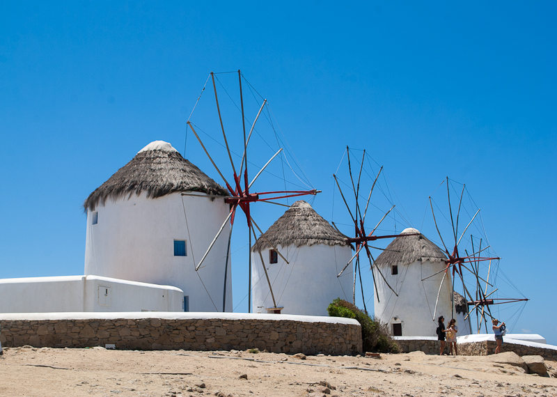 Images of the row of old windmills in mykonos town