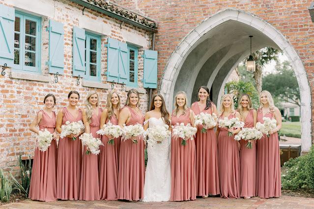 bride with bridesmaids in pink dresses at casa feliz