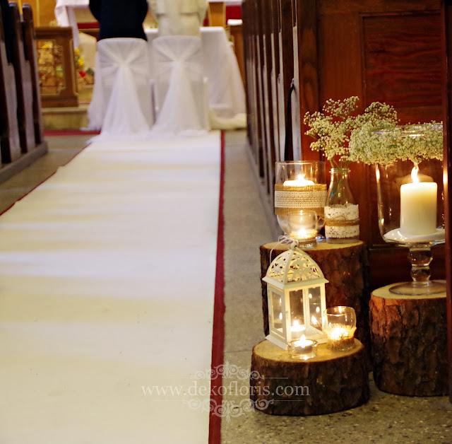 Rustykalna dekoracja ślubna kościoła biały dywan i świece Prudnik