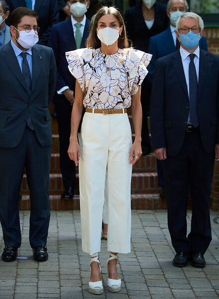 Queen Letizia wore a new double sleeve ruffle top from Psophia, and white suede espadrille wedges from Macarena, and Castaner wedges