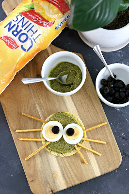 Pesto Spider Rice Cake - Healthy Halloween Snack Recipes - Healthy, gluten free, lunchbox ideas, healthy rice cake topping ideas.jpg