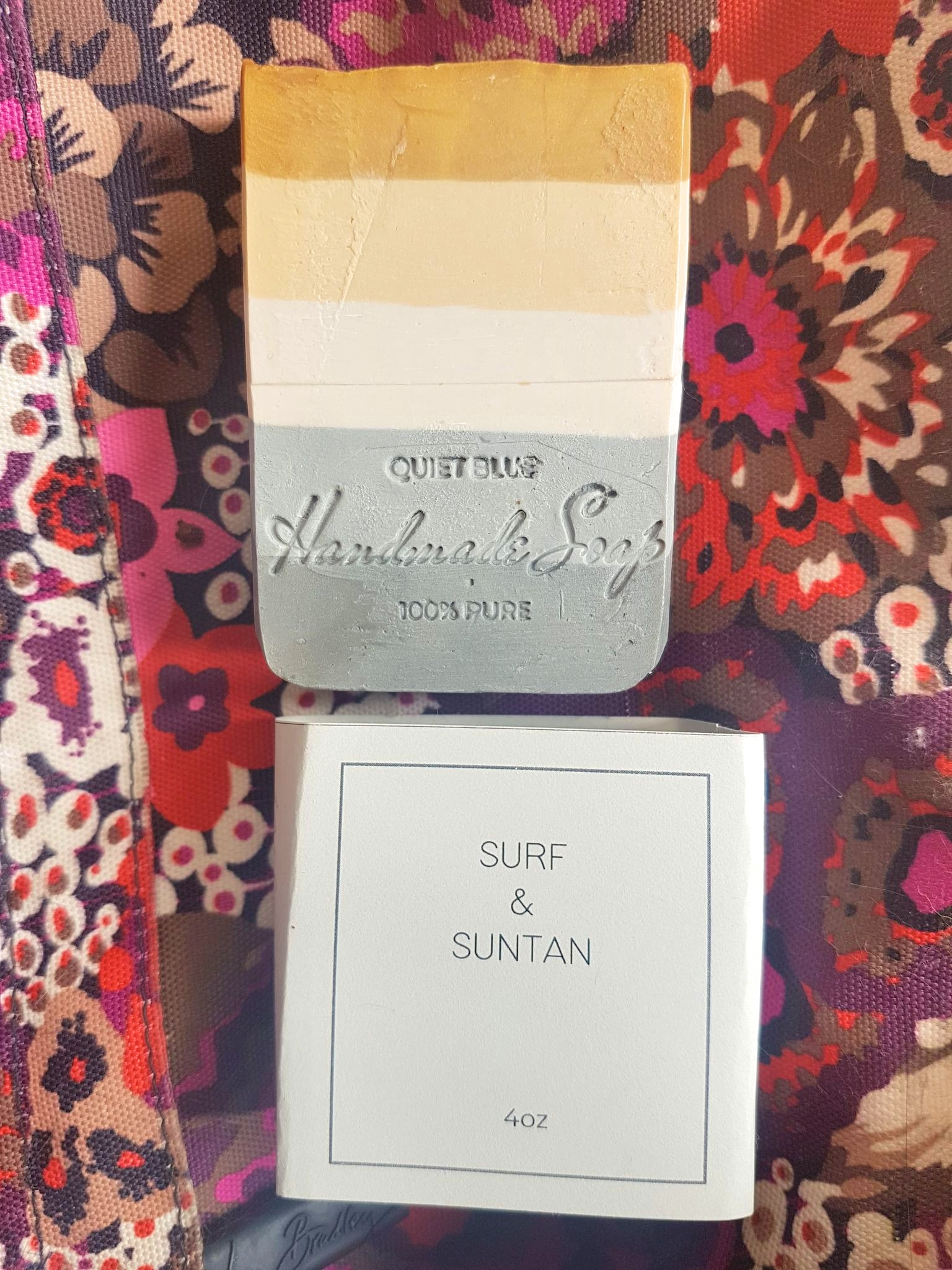 Quiet Blue Eco Natural Handmade Soap in Surf & Suntan. The soap has five layers of colour: dark grey, light grey, cream, cappuccino, and tan
