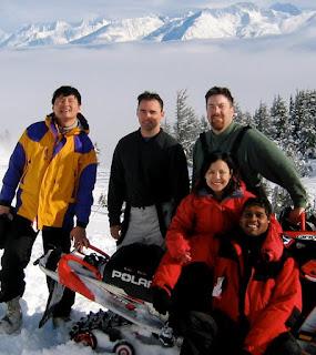 David Brodosi and friends in Alaska snowmobiling