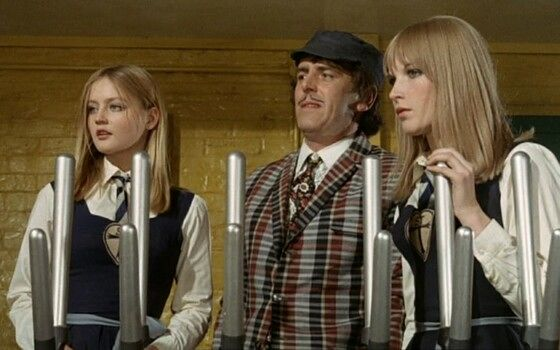 George Cole and St. Trinian's girls in a railway signal box