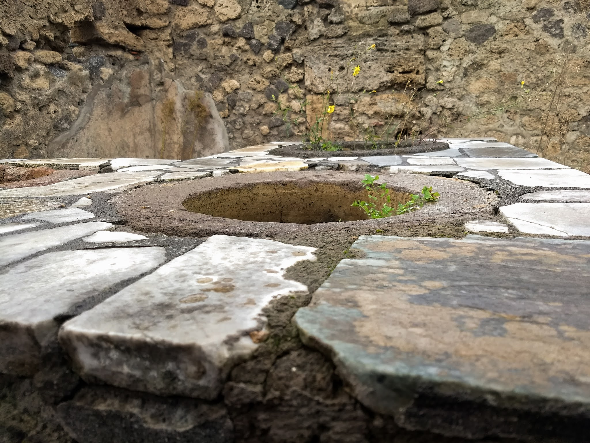 Close up of an ancient thermopolium stone stove in Pompeii
