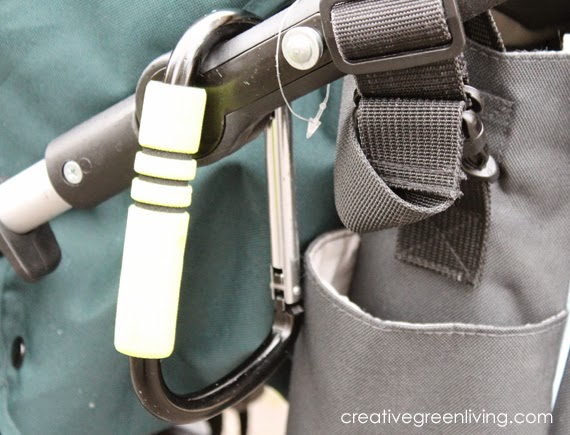 Padded clip on back of Bumbleride Indie stroller for child to hold onto