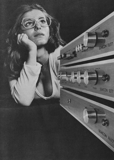 Promotional photo. Hi Fi set and attractive model wearing glasses and a low cut shirt. c. 1980s. As Seen on TV and other stories of marketing the American Dream. marchmatron.com