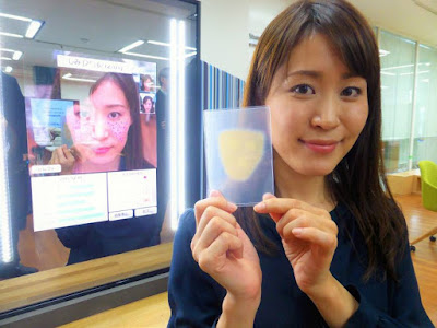 Panasonic Corp. engineer Masayo Fuchigami displays an ultrathin makeup patch during a demonstration of the Snow Beauty Mirror