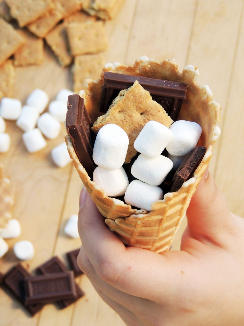These Campfire Cone S'mores are a tasty variation on the traditions s'mores recipe and are a fun way to enjoy your favorite campfire treat! #BBQ #grilling #dessert #chocolate #marshmallow #smores #recipe | bobbiskozykitchen.com