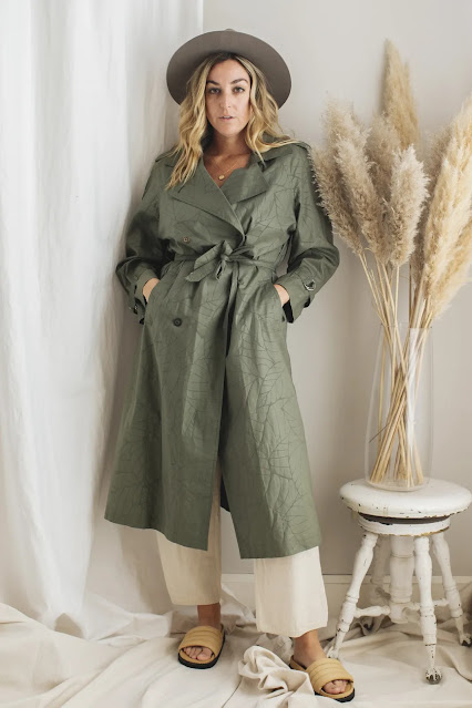 Woman wearing vintage green cotton trench coat
