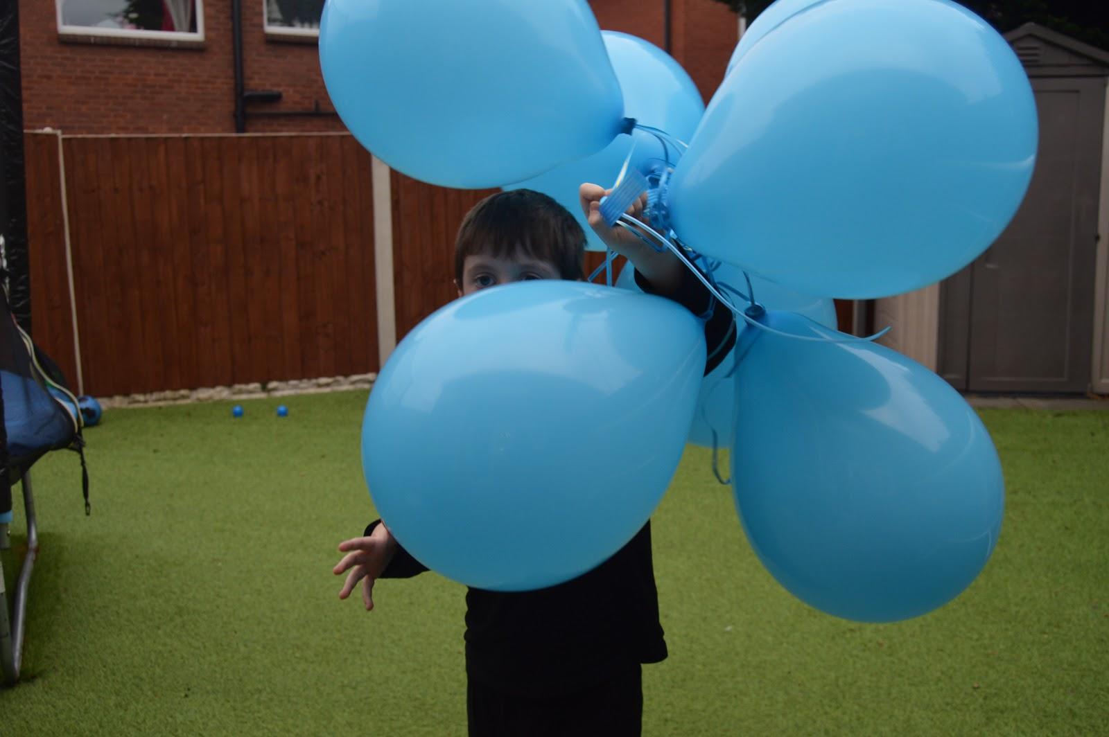 Boy holding Bunch O Balloons