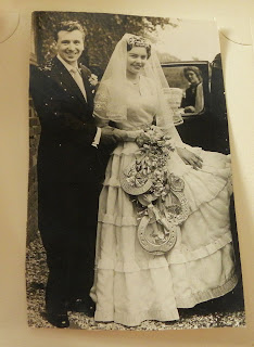 Bride and groom getting into car 1957