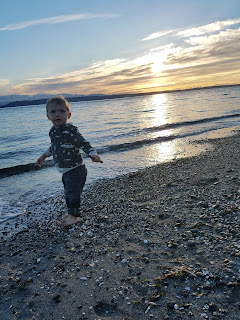 beach day with toddler at sunset
