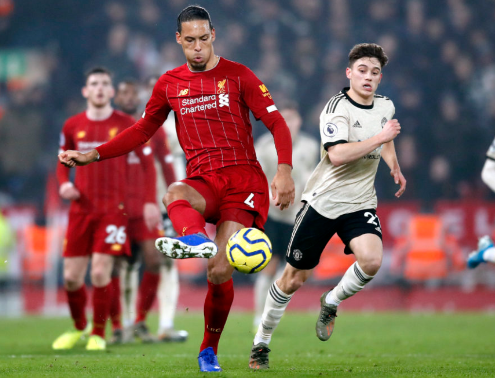 Liverpool captain Virgil Van Dijk battles away against Man United