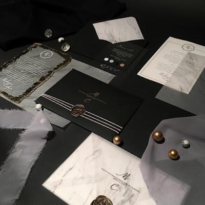 K'Mich Weddings - wedding planning - invitations - black, white invitations on black table - slvetlana