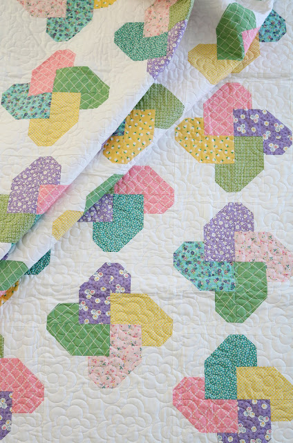 Winsome quilt pattern from the Fresh Fat Quarter Quilts book by Andy Knowlton of A Bright Corner - cute pinwheel quilt blocks and the quilt uses just 10 fat quarters