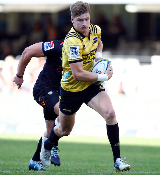 Jordie Barrett of the Hurricanes runs with ball in hand against the Cell C Sharks