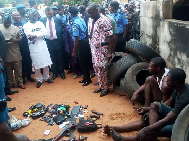 Photos: Police parade suspected armed robbers, kidnappers and a cultist wearing Red Vikings insignia