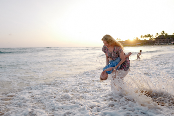 toddler braving the waves with mommy - Poipu Beach, Kiahuna Plantation, Kauai