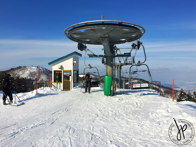 chairlift, snowy mountain, skier leaping from chairlift