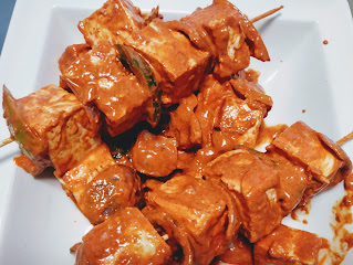 Lining paneer in wooden stick for paneer Tikka recipe