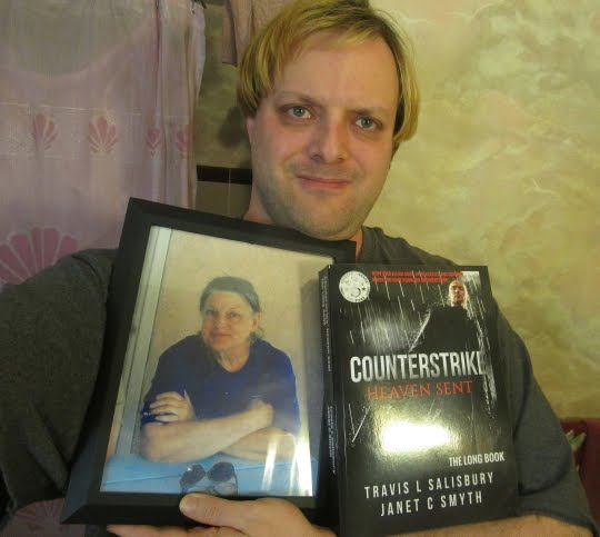 Travis L Salisbury With Counterstrike Long Book And Mother Janet-June 02 2017