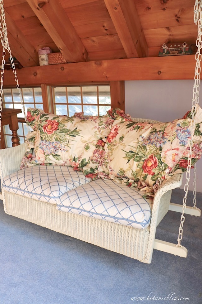 Transform a swing loft into a summery French Country space by replacing pillows.