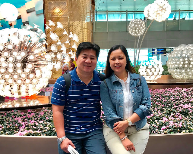 Hubby and I at Crystal Garden at Changi Airport