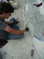 Teenager working on sanding on deck