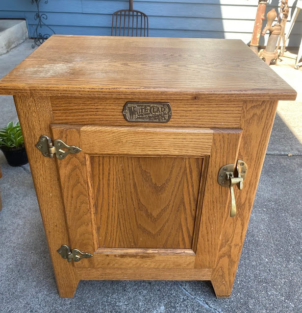 Photo of an oak end table with ice box style hardware