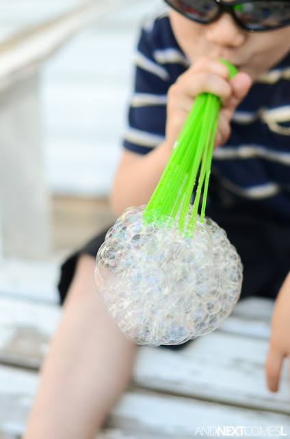 Blowing bubbles and making bubble snakes using DIY upcycled bubble blowers from And Next Comes L