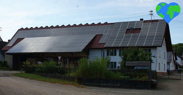 Roof with solar panels, sustainable living, sustainability, climate action
